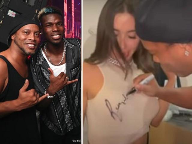 """Xôn xao clip Ronaldinho ký tên lên """"vòng 1"""" của fan nữ xinh hút triệu view"""