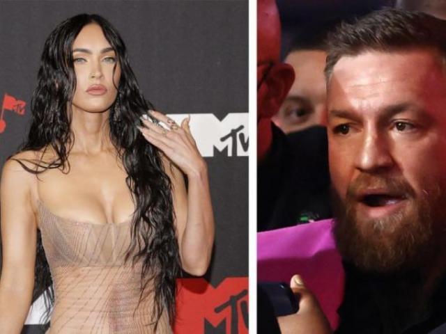 """""""Gã điên"""" McGregor làm bẩn váy xuyên thấu của mỹ nữ, suýt đấm ca sĩ"""